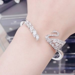 SWAN LAKE BANGLE, WHITE, RHODIUM PLATIN